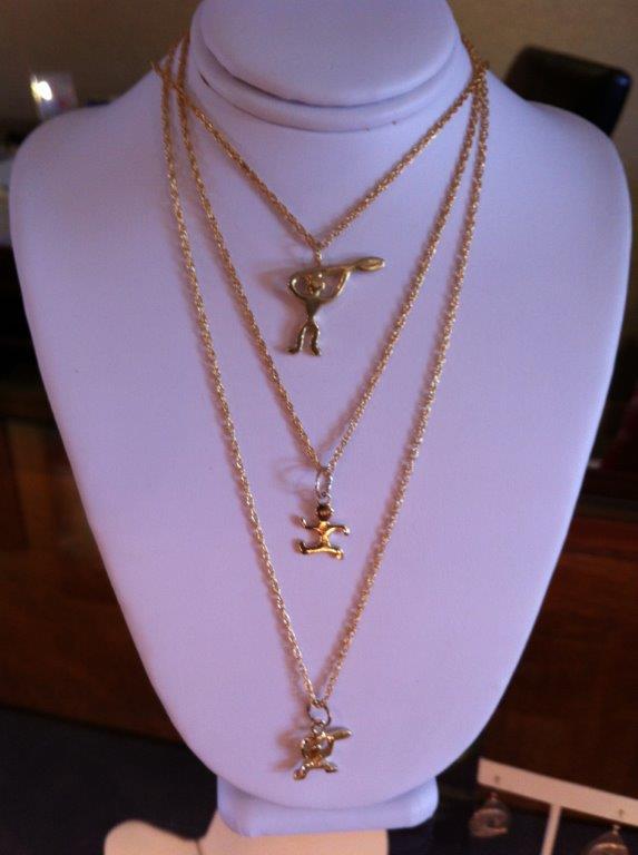 Paddler, runner, pendant and charms